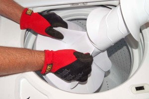 How to replace the agitator dogs in a top-load washer | Repair guide