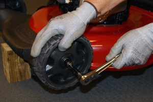 Remove the nut that holds the wheel to the axle shaft.