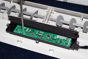 Reinstall the user interface mounting screws.
