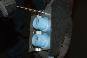 Install the inlet valve bracket screws.