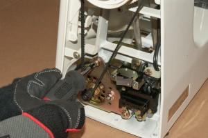 Loosen the motor mounting screws.
