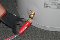 Attach the garden hose the water heater heater drain valve.