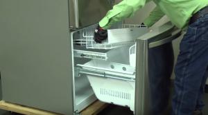 PHOTO: Reinstall the freezer shelf.
