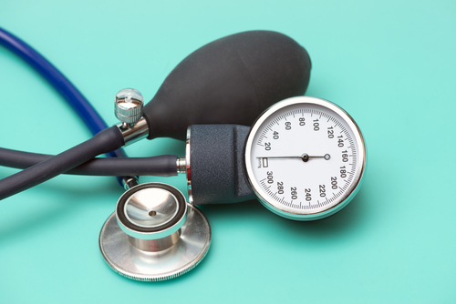 Sphygmomanometer and stethoscope on aqua background