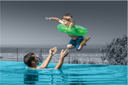Young boy jumps to his father in the pool