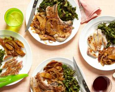 soft apples on pork chops with wilted greens