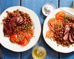 cowboy steak and pinto beans with summer tomatoes