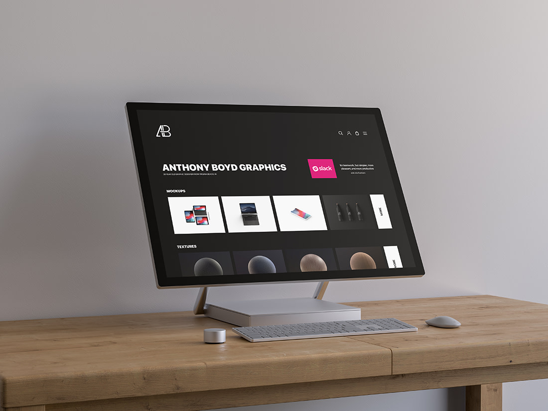 Surface Studio On Table Mockup by Anthony Boyd Graphics