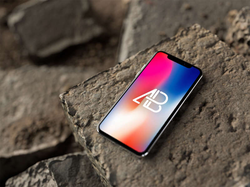 iPhone X on Rocks Mockup by Anthony Boyd Graphics