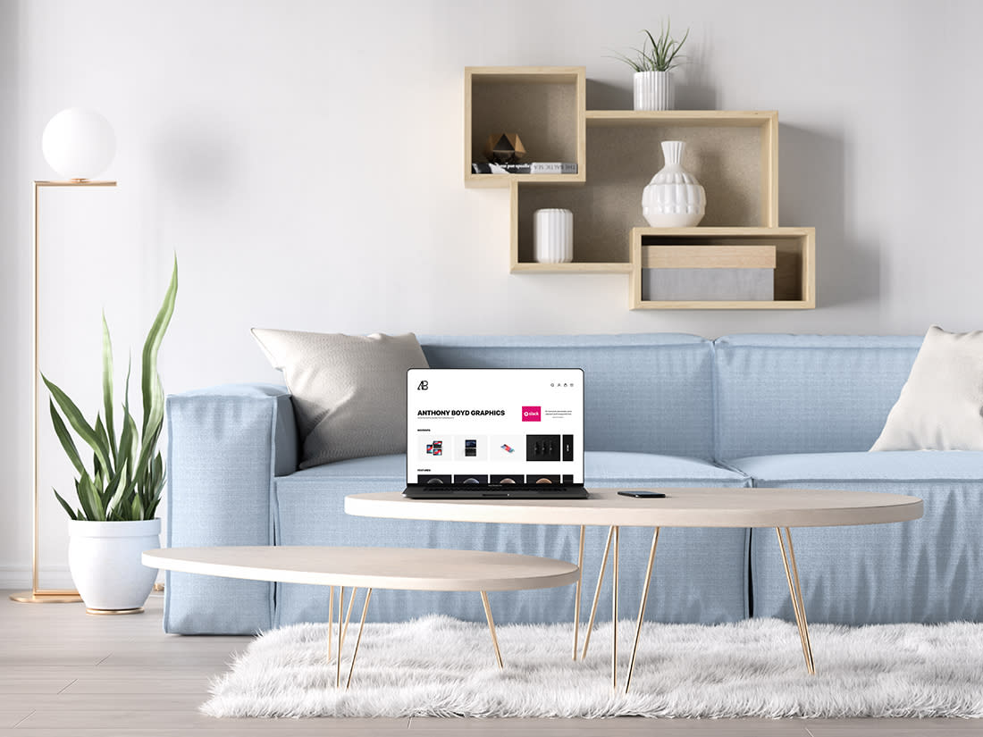 Bezel-Less MacBook Pro in Living Room Mockup by Anthony Boyd Graphics