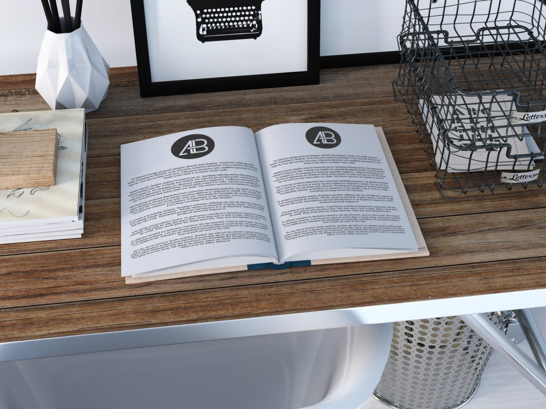 Realistic Open Book Mockup by Anthony Boyd Graphics
