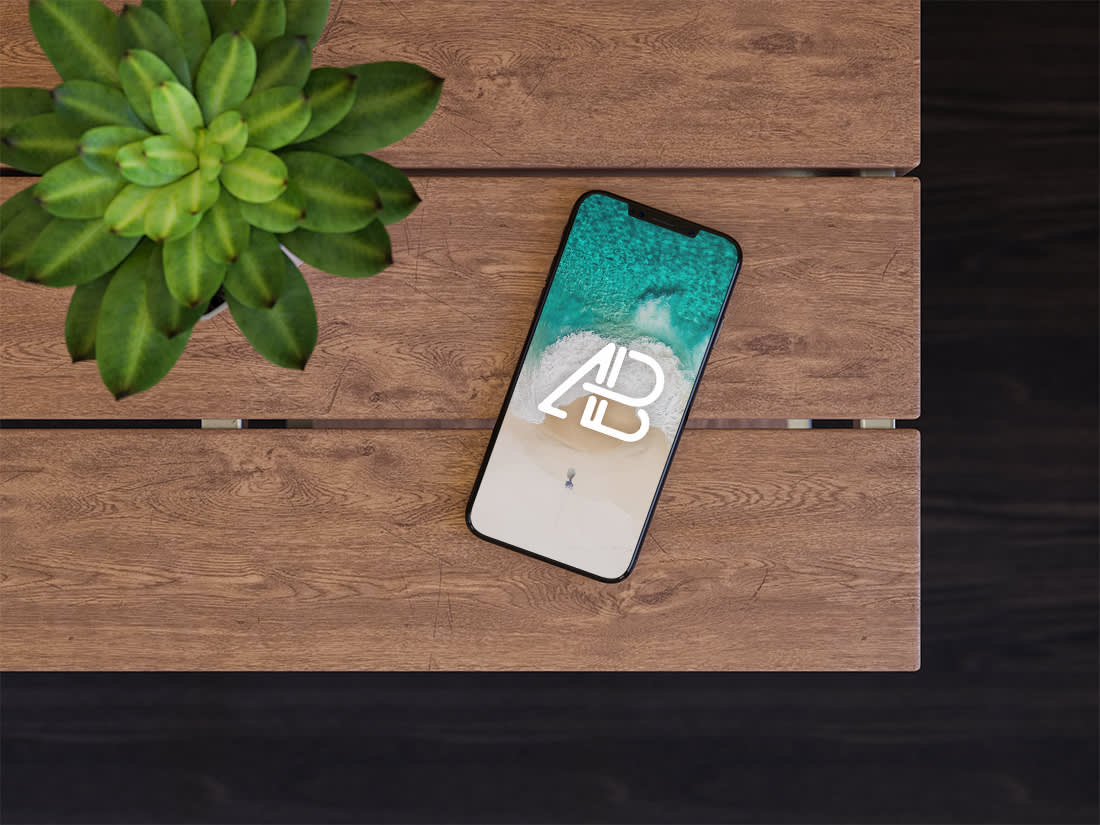 iPhone X On Table Mockup by Anthony Boyd Graphics