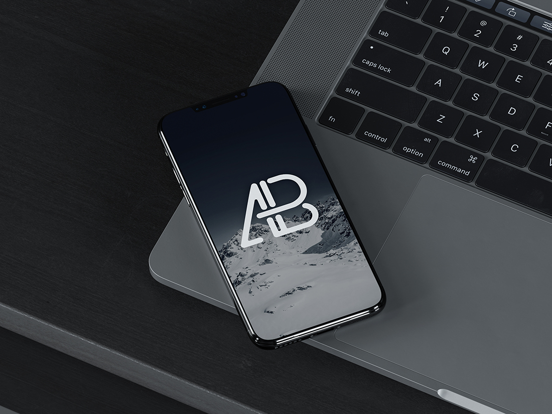 iPhone X On MacBook Pro Mockup by Anthony Boyd Graphics