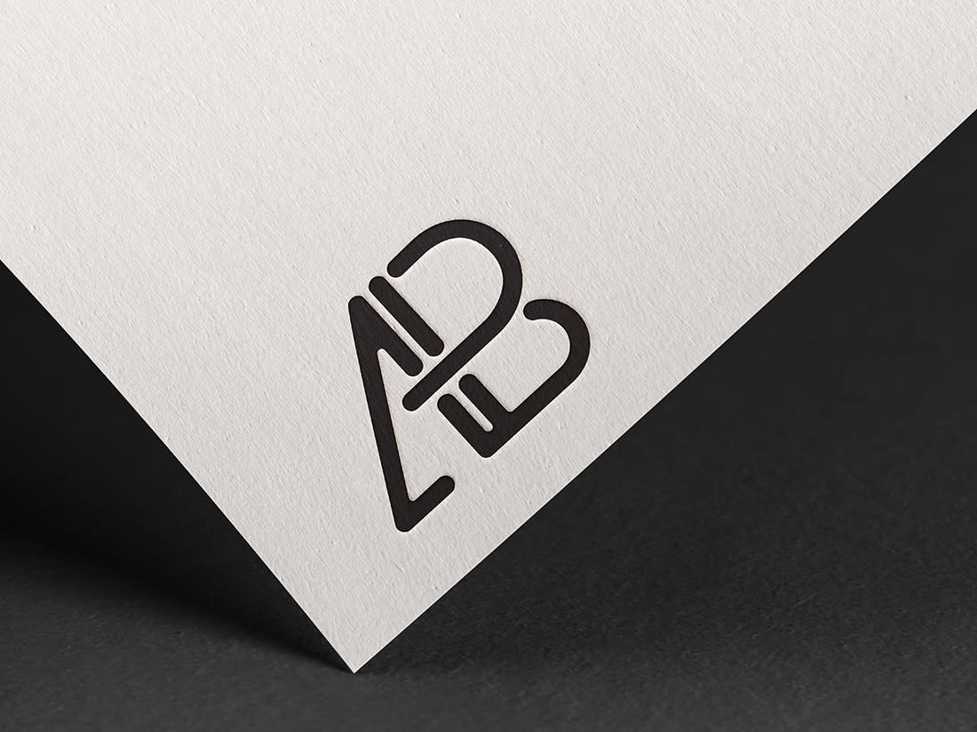 Embossed Logo Mockup by Anthony Boyd Graphics