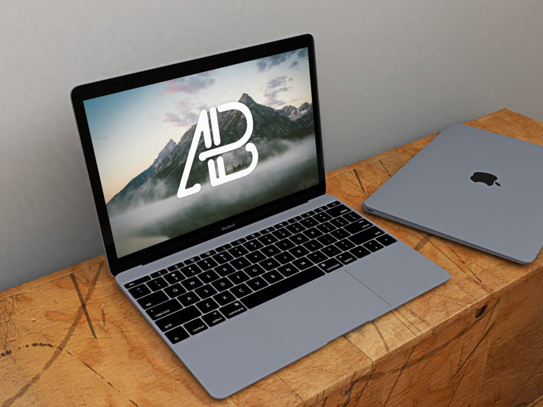 Free Realistic Space Grey Macbook Mockup by Anthony Boyd Graphics