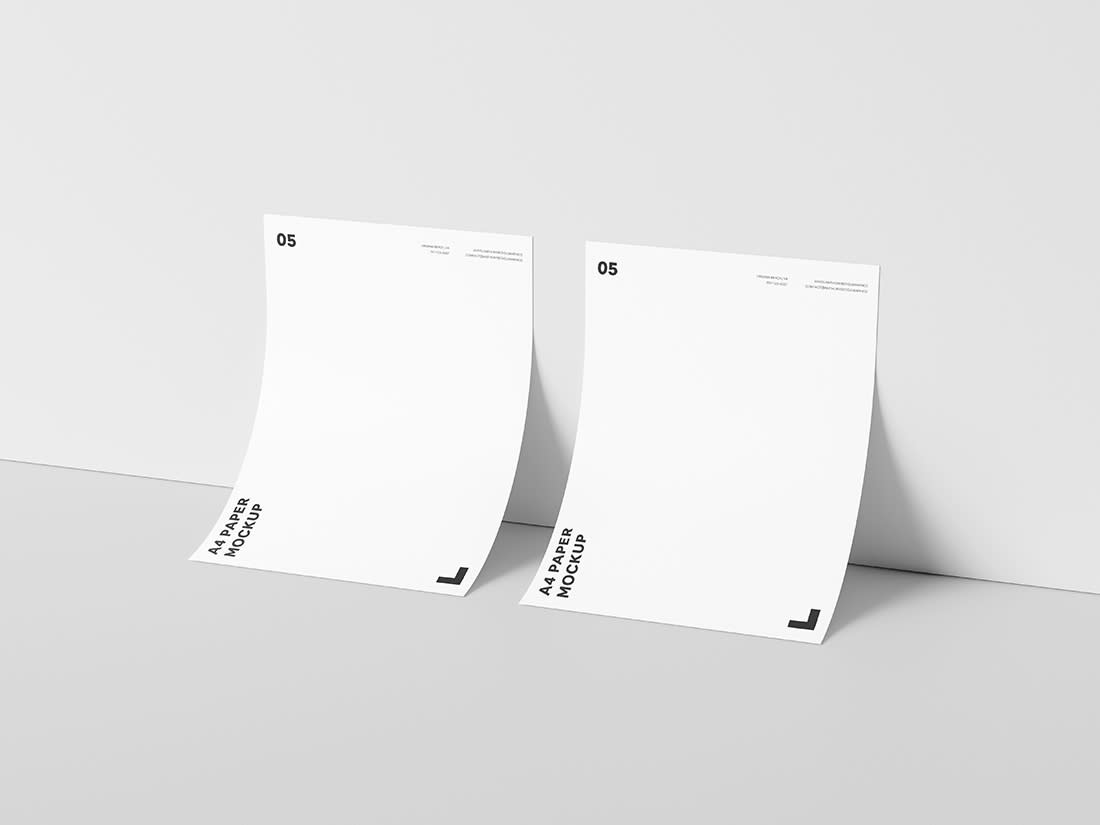 Dual A4 Paper Against Wall Mockup by Anthony Boyd Graphics