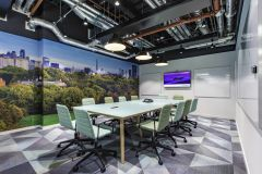 MOJ 10SC Meeting Room With Bright Wall Graphic And Exposed Ducting