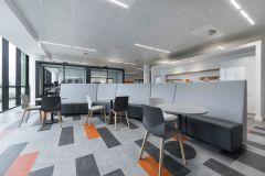 Meggitt - Bank seating with grey and orange carpet