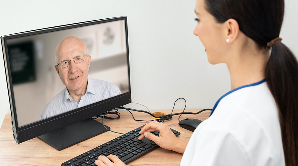 dentist consulting with a patient over a computer