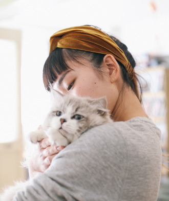 woman holding a cat in her arms
