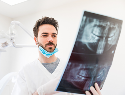 dentist examining a dental x-ray