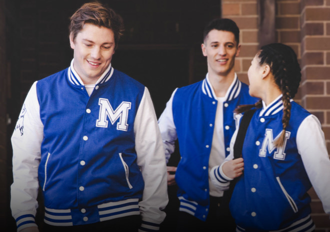 High School Students wearing custom varsity jackets