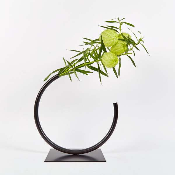 Edging Over Vase by ACV Studio