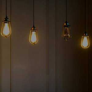 one blown light bulb and three illuminated light bulbs