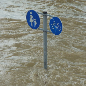 image of road sign in flood waters