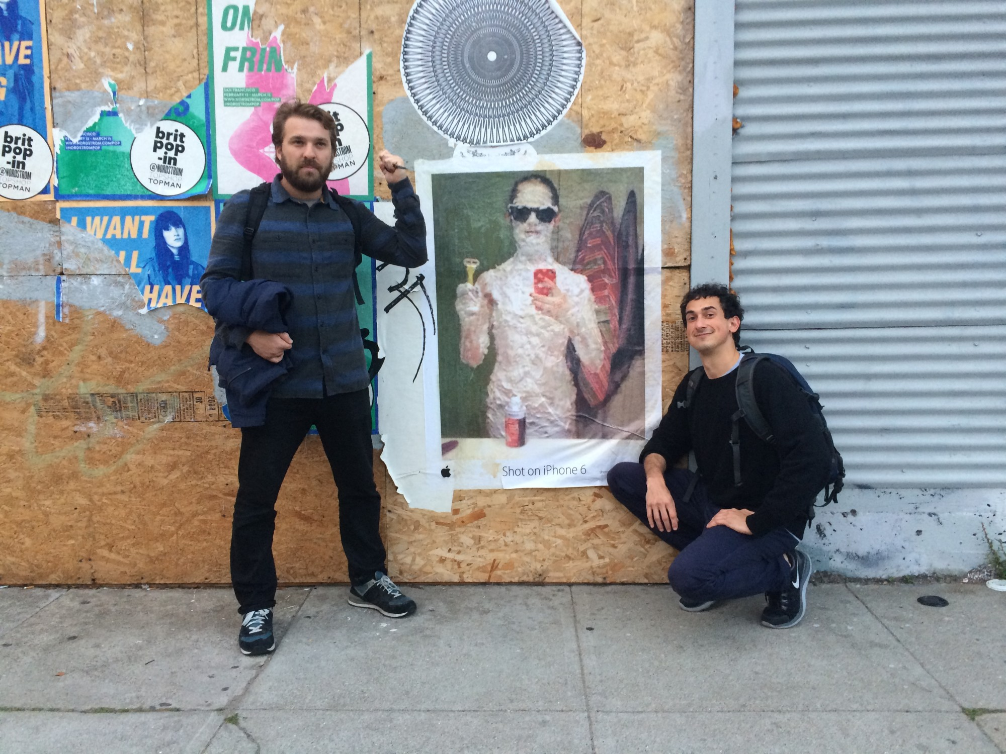 Pablo and Fabio after posting shot on iphone poster
