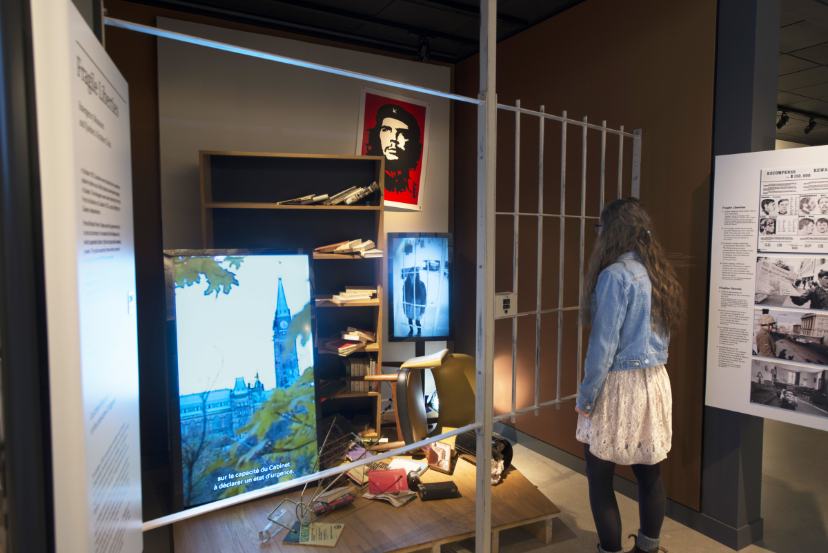 Visitor engaging with the fragile liberties exhibit