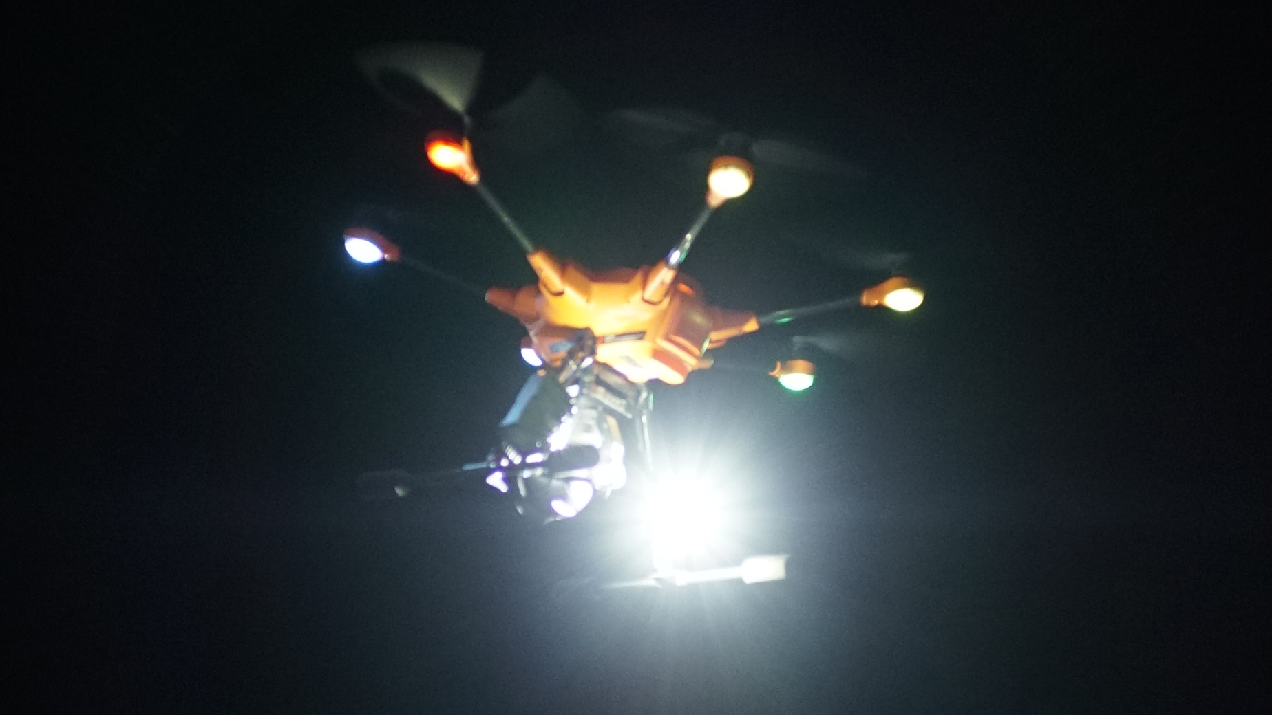 Drone with lights flying at night