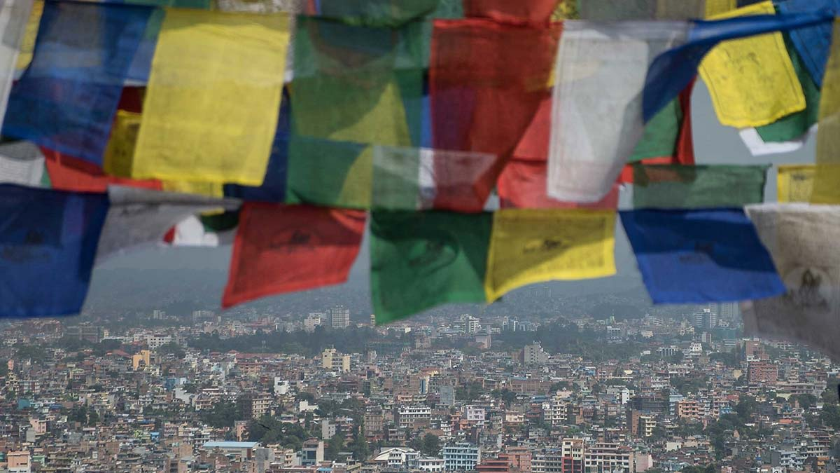 Flags fly over a Nepal devastated by earthquakes.
