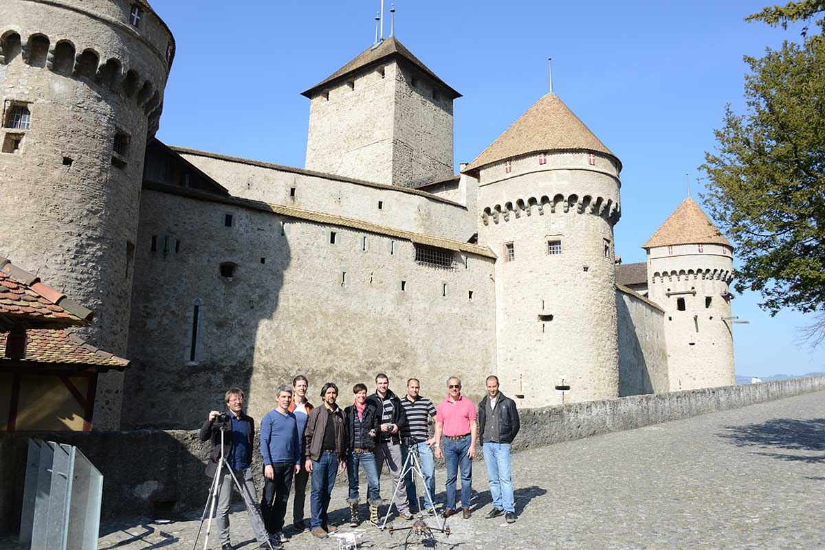 The Pix4D team standing outside Chillon castle
