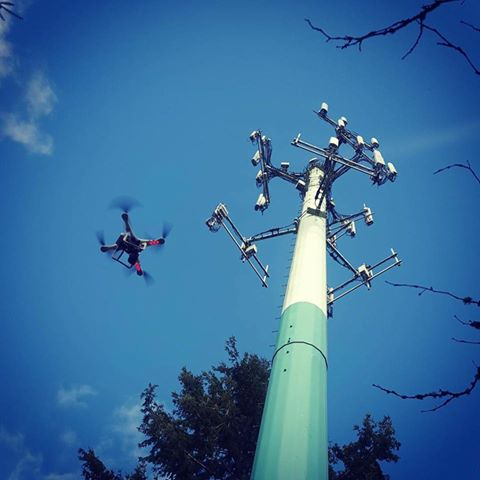 A Matrix-E Quadcopter flying over the telecommunication tower