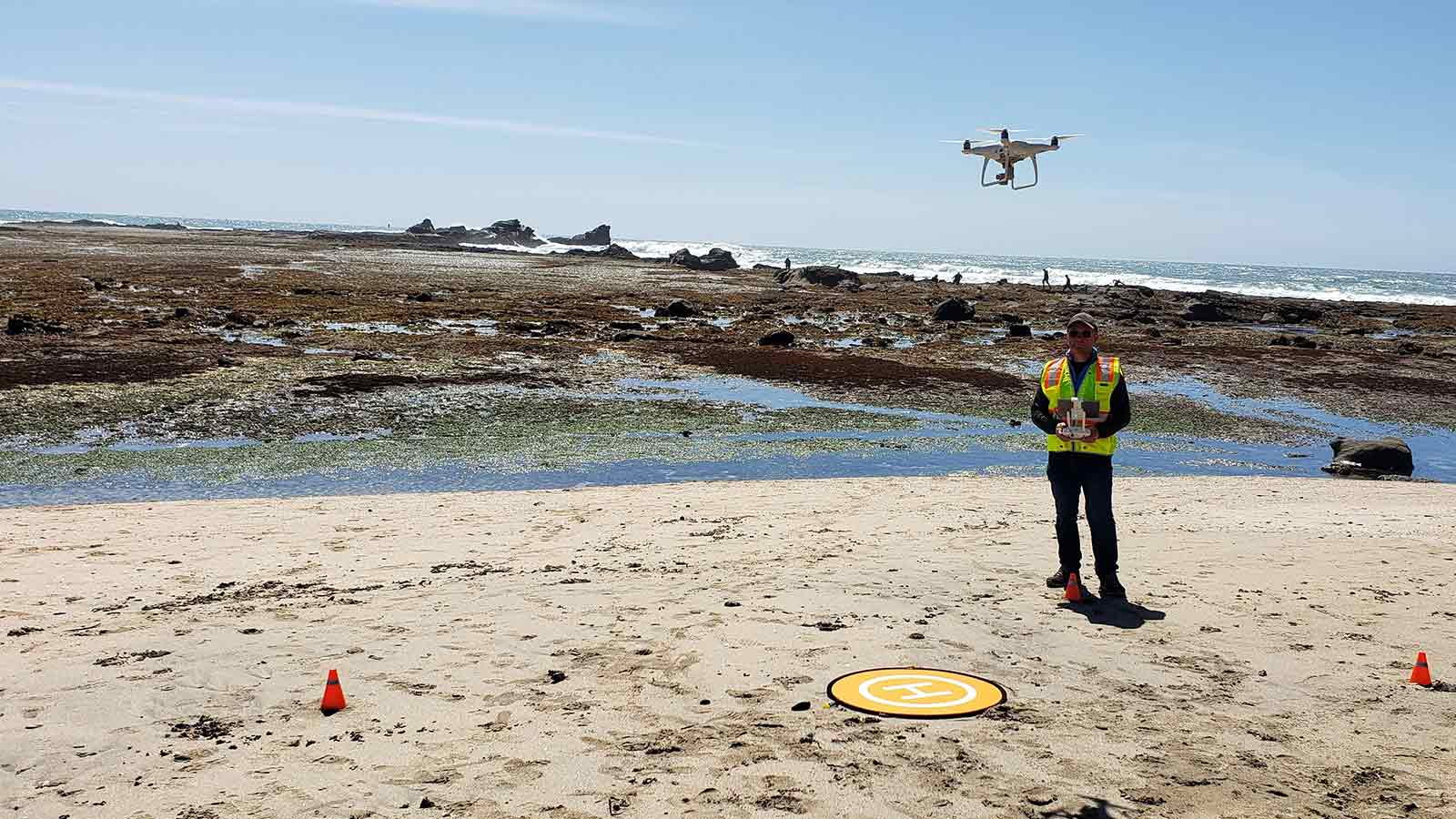 flying-a-drone-on-the-beach