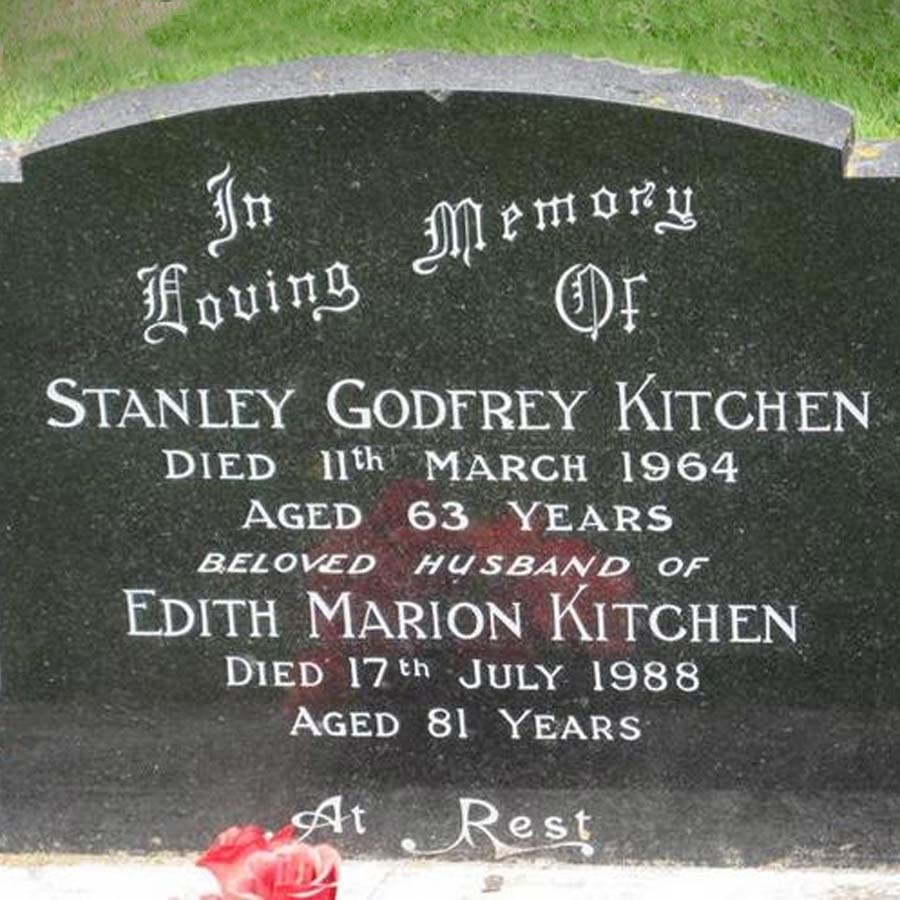 A gravestone in a cemetary