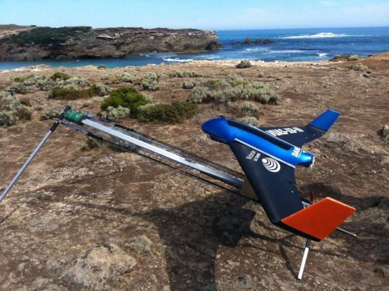 fixed-wing Skywalker X8 Flying Wing ready for takeoff from a clifftop.