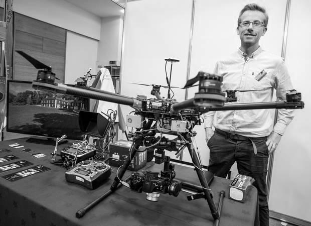 Aerial Eye founder Fearghus Foyle posing by a drone