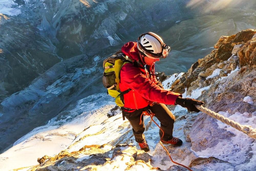 A climber ascending the Matterhorn with the help of a rope.