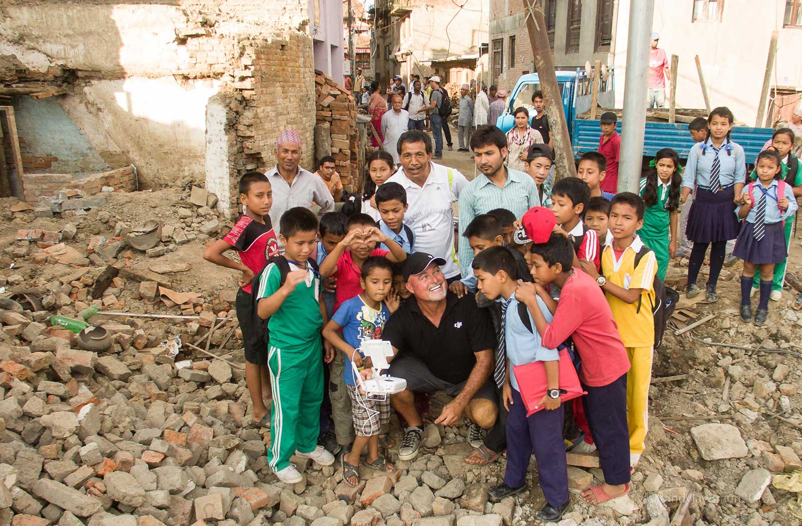 Aerial photographer showing Nepalise children the Pix4Dcapture drone flight app