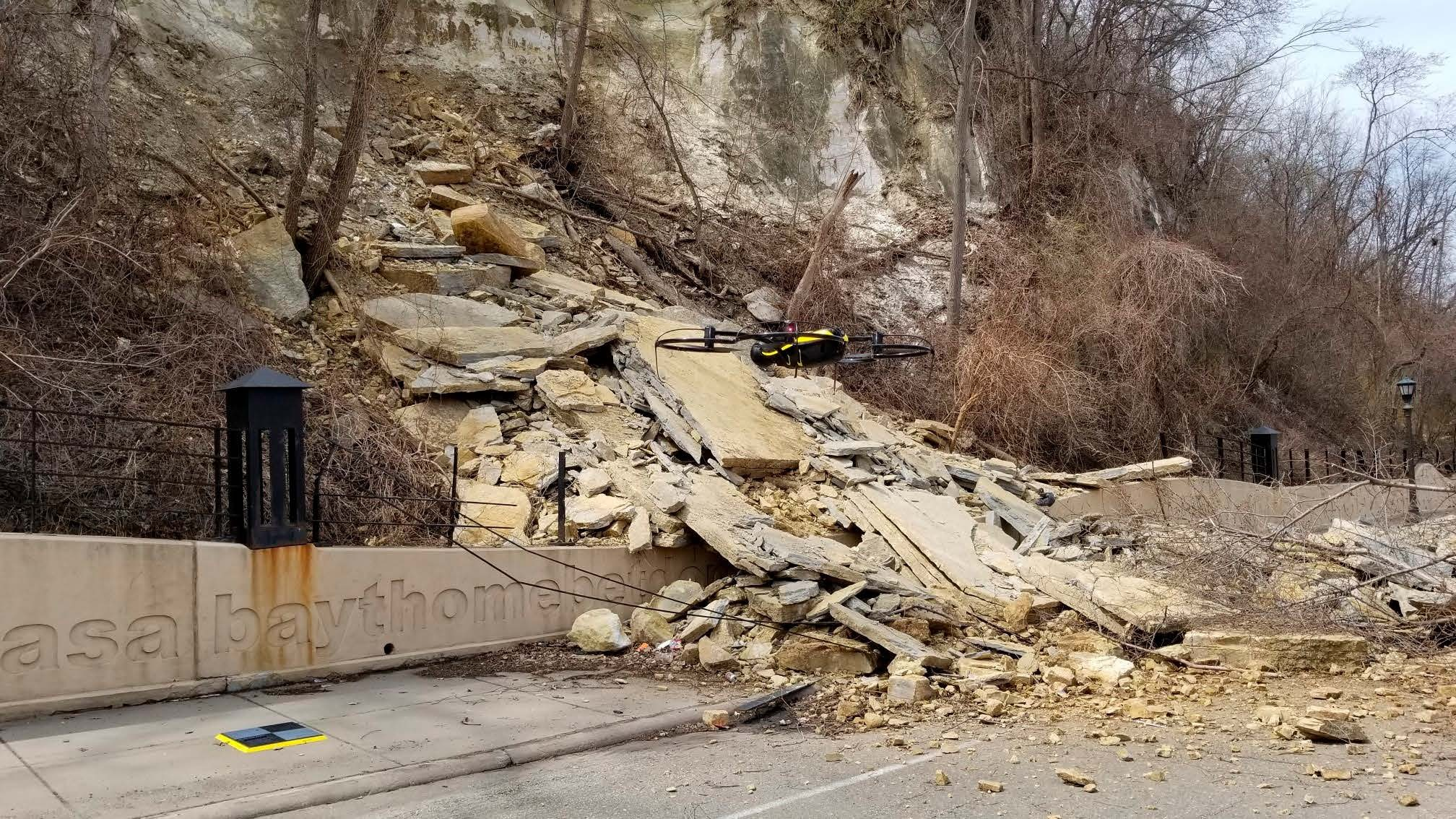 A drone hovering in front of the Wabasha Street rockslide.