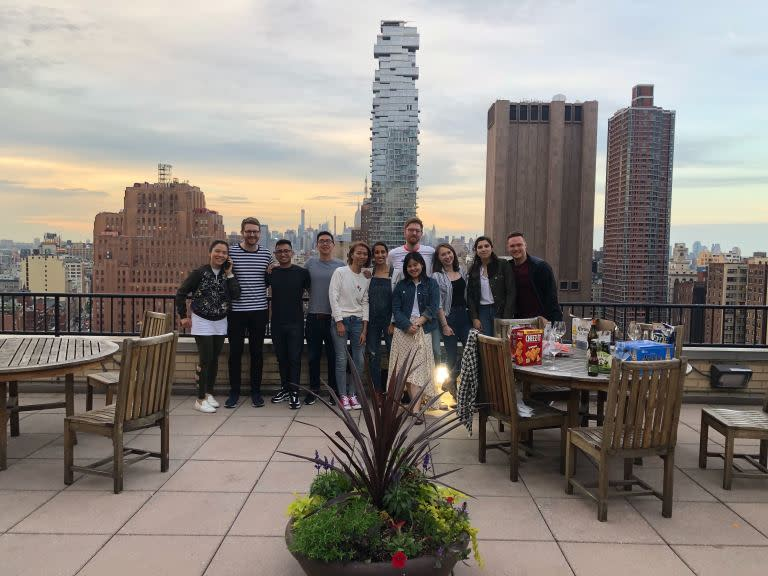 Codecademy employees smiling on a roof