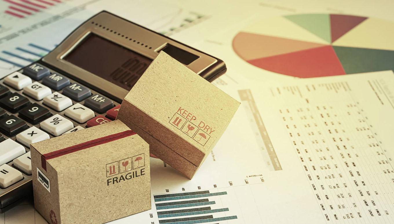 calculator, data reports and miniature cardboard boxes
