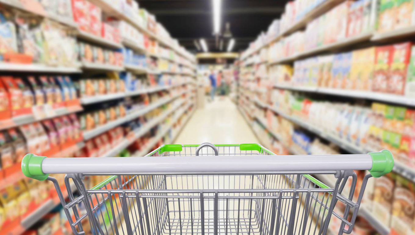 grocery aisle blurred empty shopping cart
