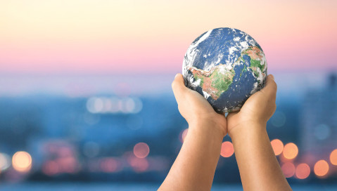 hands holding earth sphere