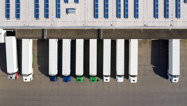 aerial view of row of semitrucks