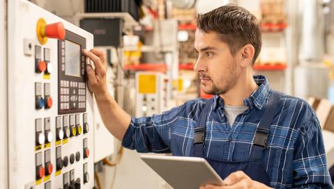 employee operating manufacturing equipment