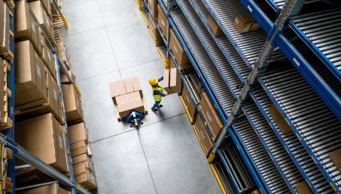 Warehouse worker with box