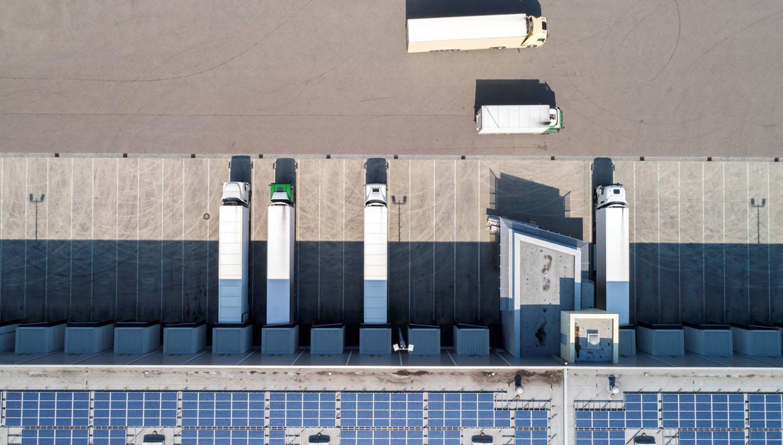 semitrailer trucks parking at warehouse